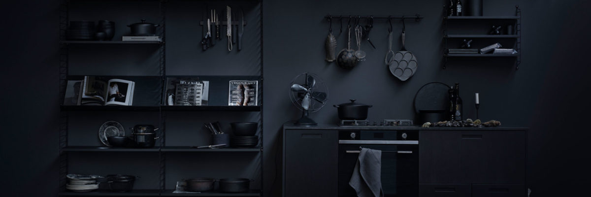Black string-shelf in black kitchen