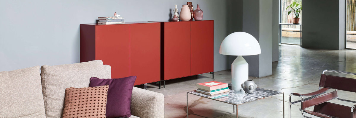 Imm cologne: Eye-Catcher, red sideboard in the living room