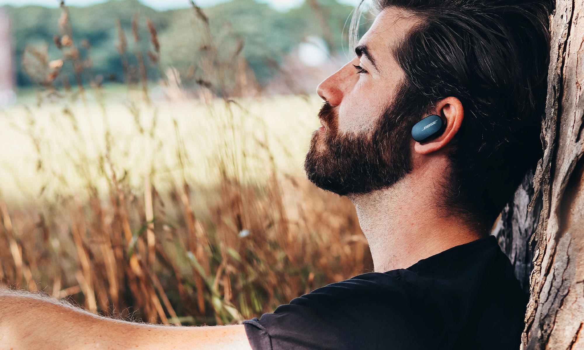man listening to music with earbuds