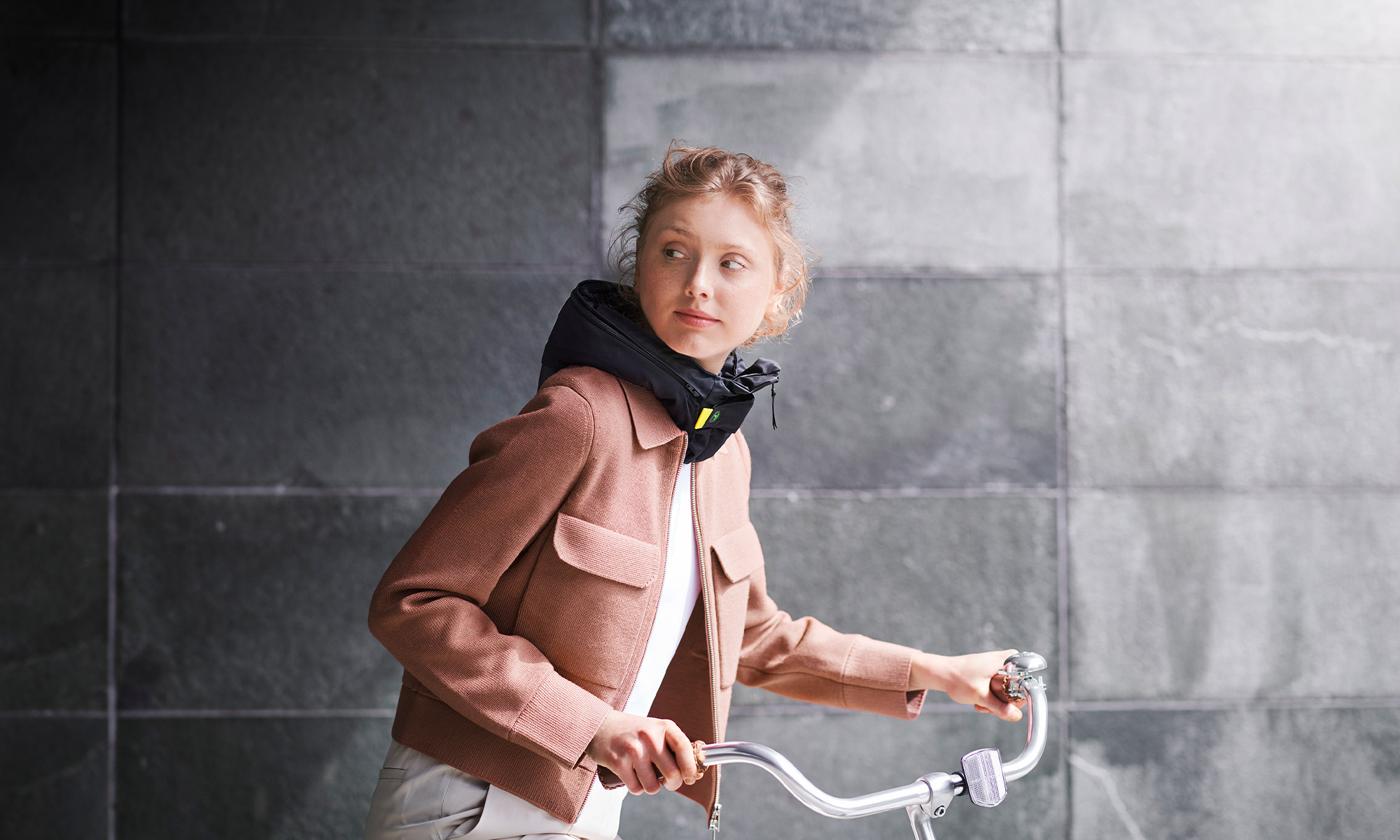 girl on a cycle with a protective headgear