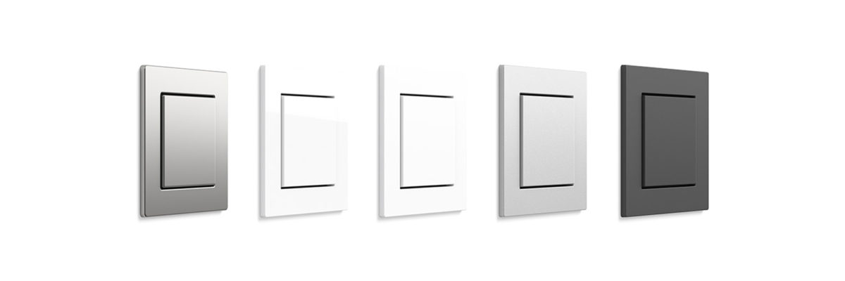 Five different stainless steel light switches on a white background.
