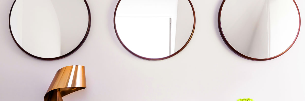 Circular mirrors, books and interior accessories.