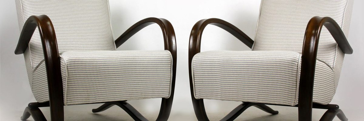 view on two chairs in the art deco interior design trend of the twenties, the h269 armchair by czech designer Jindřich Halabala