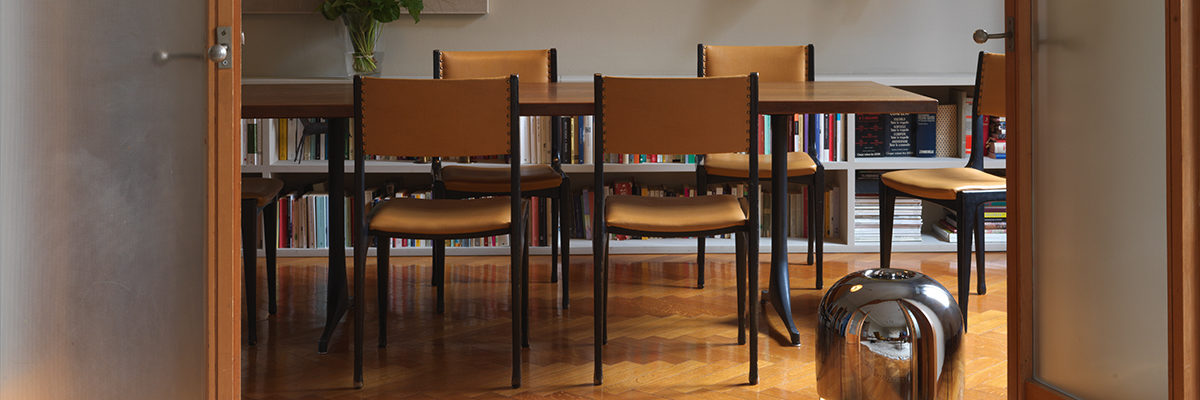 Modern electric heater Eve in dining room with bookshelf