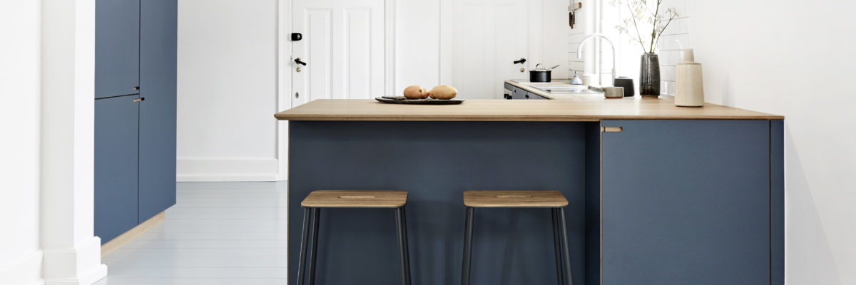blue kitchen made from solid oak