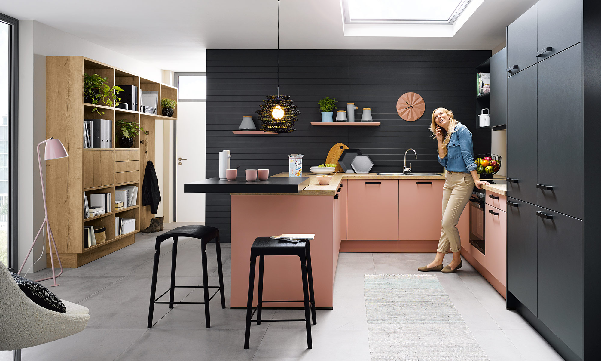 Pastel pink colour kitchen with a woman.