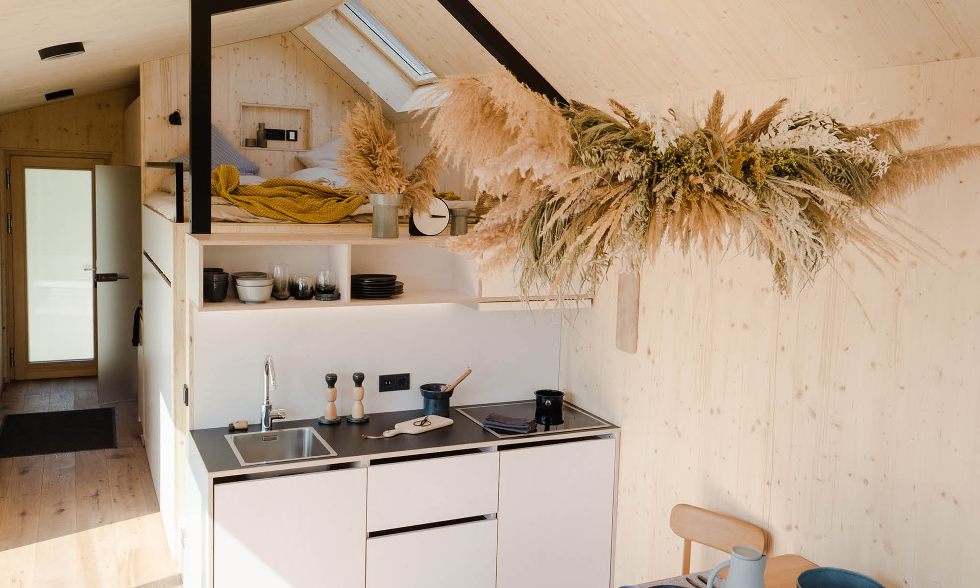 small modern kitchen in tiny house