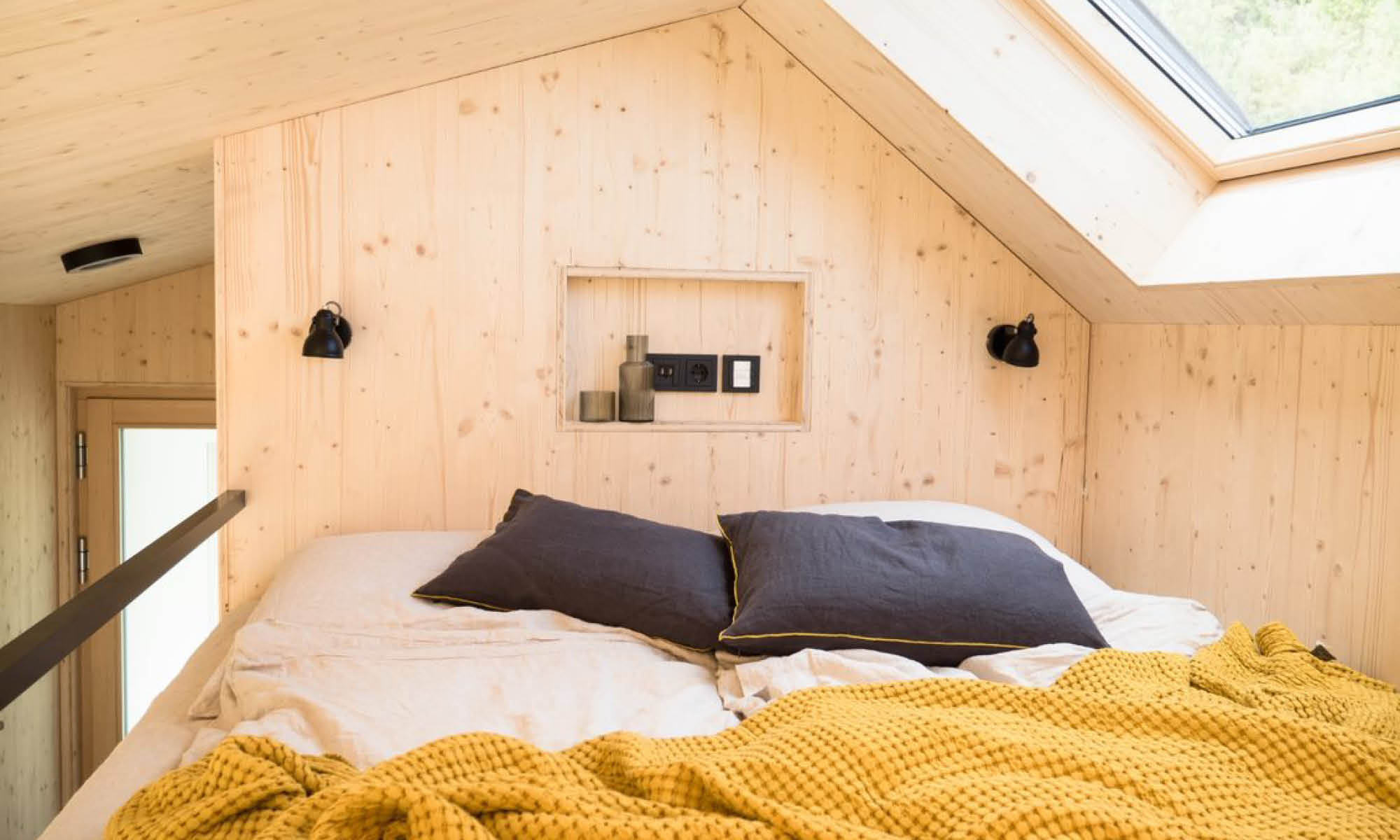 tiny house with bed under the roof